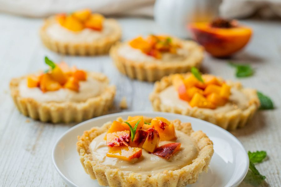 Vegan mini peach custard tarts